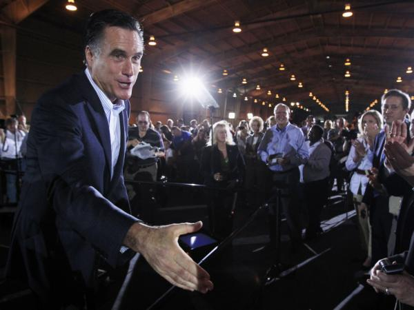 Mitt Romney greets audience members at the National Gypsum Co. in Tampa, Fla., Tuesday, Jan. 24, 2012.