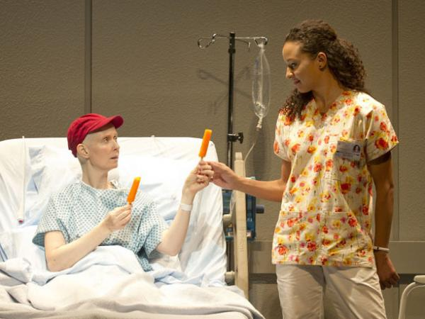 Vivian shares a moment of connection with her nurse Susie (Carra Patterson).