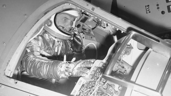 Marine Lt. Col. John Glenn demonstrates operations inside a Mercury capsule on Jan. 11, 1961.