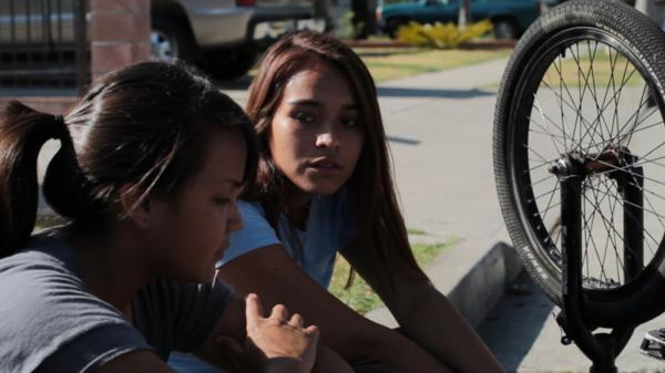 "Fenessa Pineda (left) plays Yolanda, nicknamed ""Mosquita,"" and Venecia Troncoso plays Mari in <em>Mosquita y Mari</em>, a film about the budding love between two Chicana teenagers."