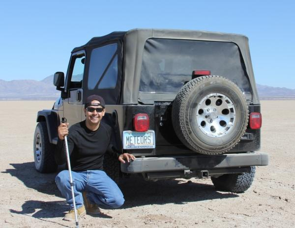 Meteorite hunter Ruben Garcia and his Jeep.
