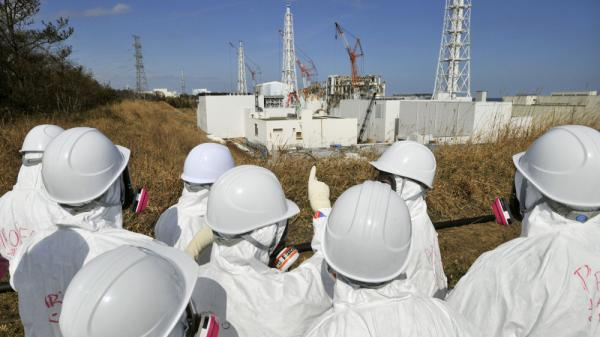 Members of the media, wearing protective suits and masks, visit the tsunami-crippled Fukushima nuclear power station during a press tour, in northeastern Japan's Fukushima prefecture, Feb. 28. Japan is marking the first anniversary of the March 11 tsunami and earthquake, which triggered the worst nuclear accident in the country's history.