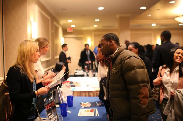 While parts of the U.S. economy struggle, other sectors are seeing growth. Here, job seekers talk with recruiters at a career fair in Manhattan last month.