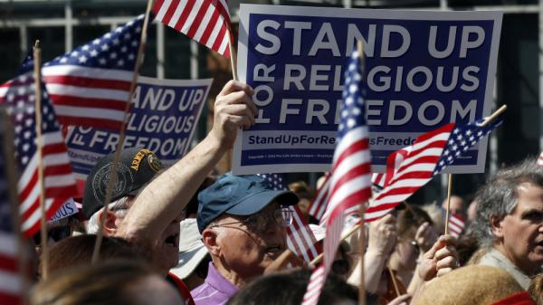 Protesters rally for religious freedom in front of Philadelphia's Independence Hall on Friday. Rallies took place nationwide to protest the mandate that some religious organizations cover the cost of contraception.
