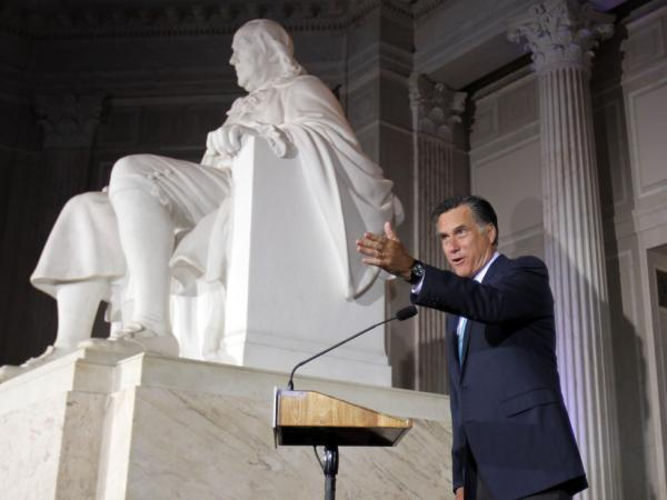 Courting Tea Party voters in Philadelphia on Monday night, Mitt Romney speaks next to a large statue of Benjamin Franklin at the Franklin Institute.