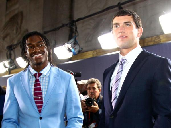 After the lights turn elsewhere, former NFL player Nate Jackson warns top draft picks Robert Griffin III, left, and Andrew Luck that their every breath will be a public affair.