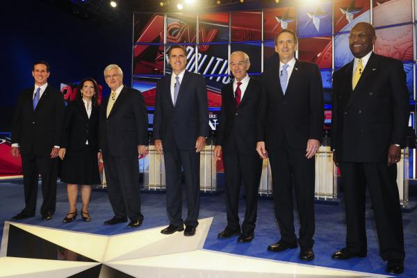 Santorum joins the field of candidates on stage in Manchester, N.H., before a GOP presidential debate on June 13.