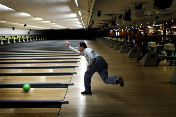 Santorum gets in some bowling at Sabre Lanes in Menasha, Wis., following a campaign rally on April 2.
