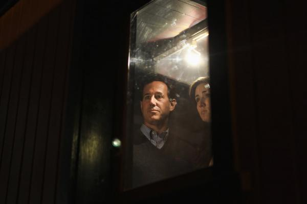 Santorum tours a vintage train car on April 1 in Green Bay, Wis. His loss in Wisconsin led many pundits to declare his campaign over.