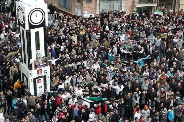 Anti-government protesters gather in Homs on Jan. 20, to demand that Assad agree to an Arab League plan to end the bloodshed.