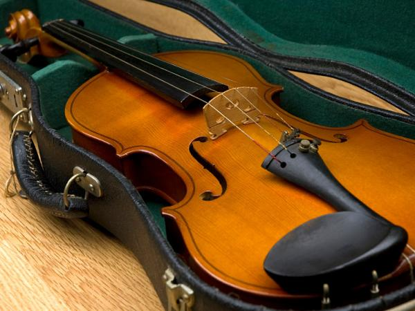 Recent revisions to British Airways' carry-on luggage rules can confuse travelers with musical instruments.