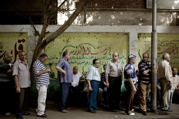 Egyptian men line up to vote at a polling station in the Shobra neighborhood of Cairo on Sunday.