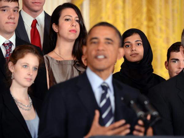 College students surrounded President Obama earlier this month when he called on Congress to stop student loan interest rates from doubling. Congress agreed on a deal to prevent the hike on Friday.