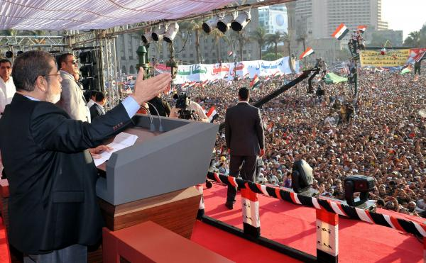 The Egyptian Presidency released this image of Mohammed Morsi giving a speech to tens of thousands of people in Cairo's Tahrir Square on Friday. Morsi was sworn in as Egypt's president on Saturday.