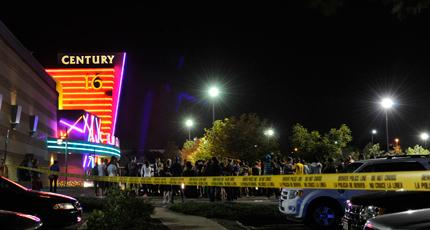 "Calls to police started coming in at about 12:30 a.m. from a theater in Aurora, Colo., showing ""The Dark Knight Rises."""
