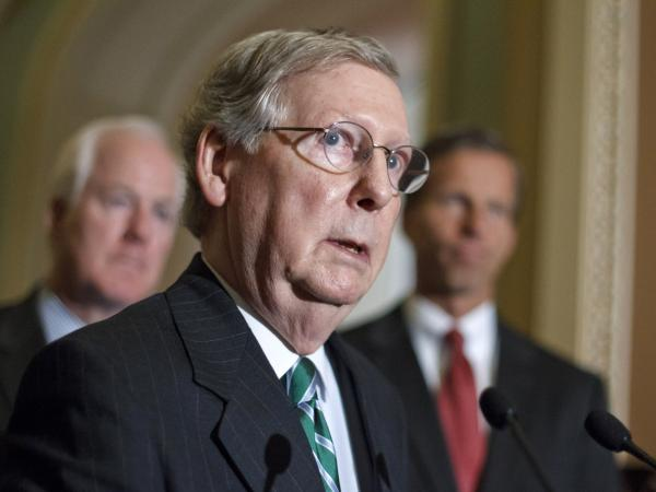 Senate Minority Leader Mitch McConnell says covering the uninsured shouldn't be Republicans' top health priority.