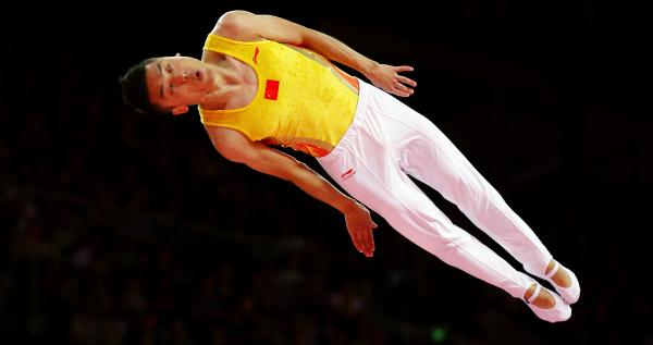 Chinese trampoline gold medalist Dong Dong competes in London. An analysis by Yahoo finds that China's Olympians outpace their U.S. counterparts in judged competitions, such as trampoline and diving.