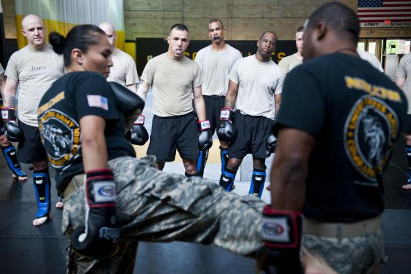 <p>Student instructors watch combat movements before a sparring exercise at the U.S. Army Combatives school. The Army has been conducting a study to see how many soldiers sustain concussions during the training.</p><p></p>