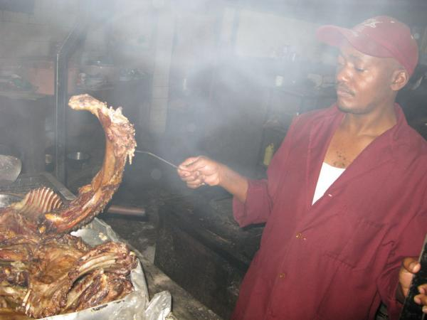 Kenyan cook Mwangi grills up <em>nyama choma,</em> which usually involves nearly all the parts of a goat, at the popular Sagret Hotel in Nairobi.