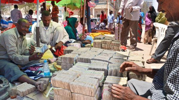 Bundles of Somaliland's own currency bills are laid out by a money-changer on a street in Hargeisa, capital of the unrecognized breakaway republic of Somaliland in northwestern Somalia. Investors are beginning to move into the untapped market in Somaliland, a stable island in a turbulent region.