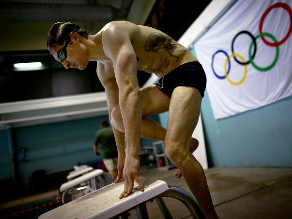 Lt. Brad Snyder mounts the starting blocks while training on his starting technique. Snyder was permanently blinded last year by an IED in Afghanistan, and is now competing in the Paralympics in London.