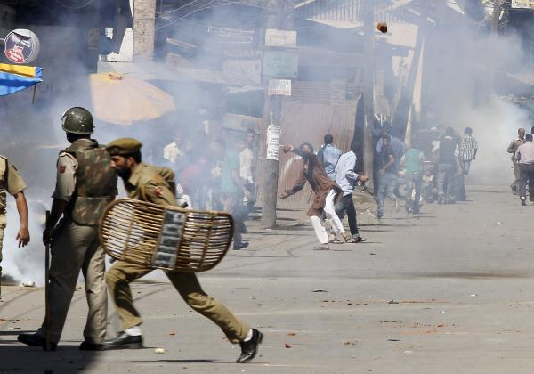 "Kashmiri Muslim protesters throw stones at Indian policemen during a protest in Srinagar, India. The protest was held against an anti-Islam film called ""Innocence of Muslims"" that ridicules Islam's Prophet Muhammad."