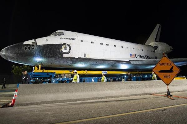 The space shuttle Endeavour is seen atop the Over Land Transporter after exiting the Los Angeles International Airport on its way to its new home at the California Science Center in Los Angeles