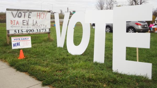 Organizers erected signs to draw attention to a one-day voting station at a Latino grocery in Des Moines, Iowa. Satellite voting locations are designed to make early voting more convenient.