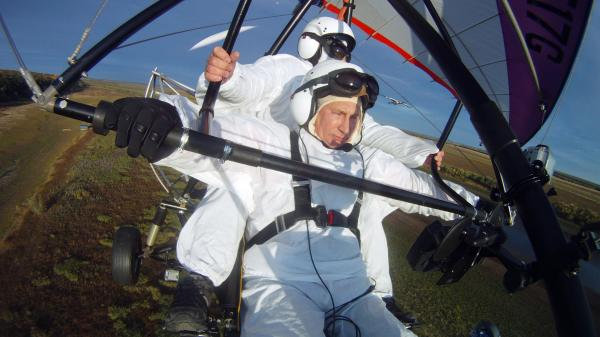 Russian President Vladimir Putin pilots a motorized hang glider while taking part in a project to help endangered cranes on Sept. 5. Shortly after, the president — who has cultivated the image of a man of action — was photographed wincing in apparent pain.
