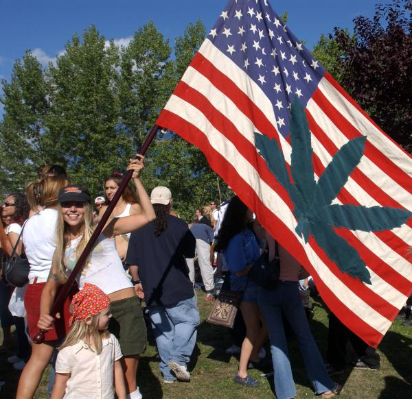 Betsy Burbank shows off her homemade flag at Seattle's Hempfest in August 2003.