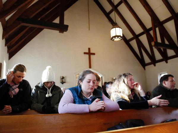 Parishioners attend a prayer service at Saint Johns Episcopal Church near Sandy Hook Elementary School in Newtown, Conn.