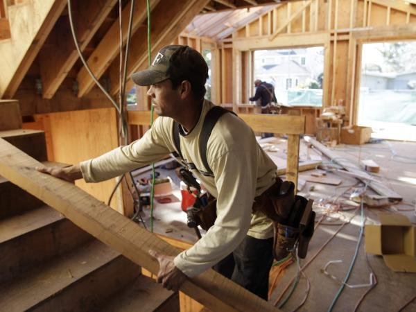 Construction workers build a home in Palo Alto, Calif. A real turnaround seemed to take hold in the housing sector in 2012 after years of fits and starts.