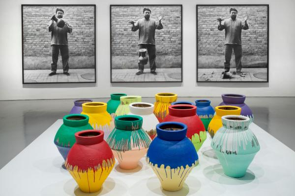 Ai's most controversial work involves altering revered objects, like these paint-covered ancient Chinese vases, or destroying them altogether, as shown in the photographic triptych, <em>Dropping a Han Dynasty Urn</em>.