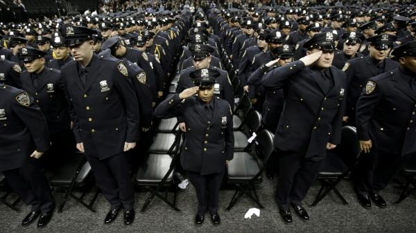 A New York City police academy graduation ceremony on Dec. 28, 2012, where Mayor Michael Bloomberg announced that the New York murder rate has hit an all-time low. While some point to the NYPD's policing tactics to explain the decline, others say economic and demographic shifts are also at work.