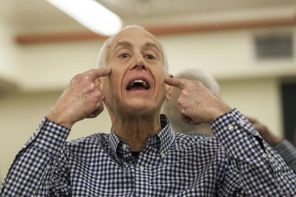 John David, 73, teaches an exercise class to seniors in New York City. His routine goes through every muscle, including those on the face.