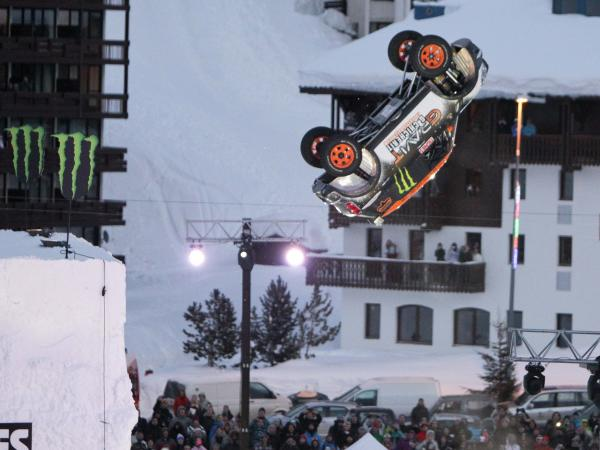 Driver Guerlain Chicherit in his Mini Countryman, doing a backflip on Sunday in France.