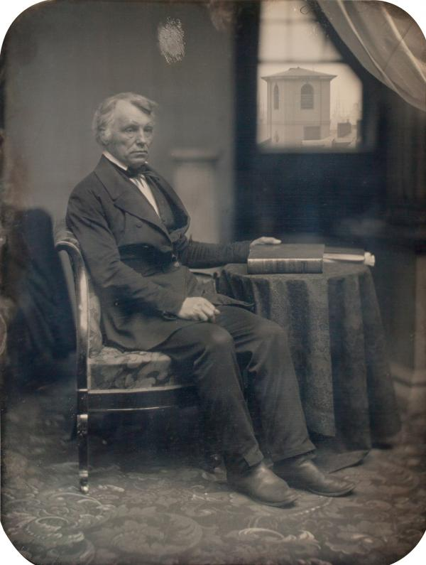 <em>Seated man with Brattle Street Church seen through window</em>, 1850s (Albert Sands Southworth, Josiah Johnson Hawes)