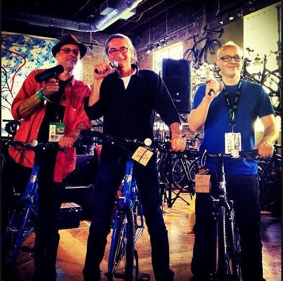 """Bikes with mics. Bob Boilen, KEXP's Kevin Cole and Robin Hilton at Mellow Johnny's Bike Shop and a live Broadcast #sxsw"" - from @tinydesk on Instagram."
