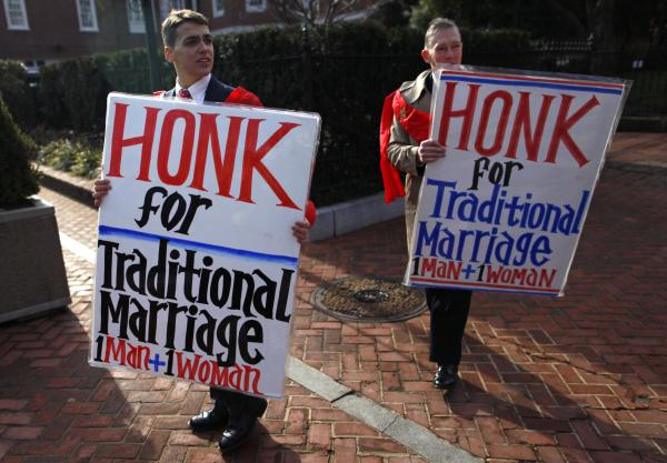 "Zachariah Long (left) and Edward Ritchie protested last year against a gay marriage bill in Maryland. In 1973, Maryland became the <a href=""http://www.npr.org/2013/03/21/174732431/timeline-gay-marriage-in-law-pop-culture-and-the-courts"">first state</a> to define marriage as a union of one man and one woman. Voters there legalized gay marriage in 2012."