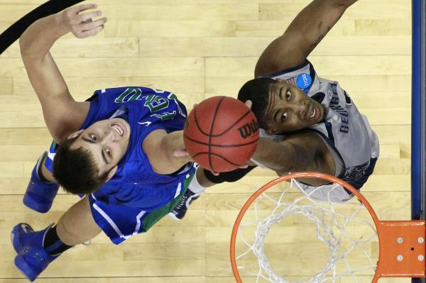 Florida Gulf Coast's Chase Fieler (left) and Georgetown's Mikael Hopkins leap for a rebound during a second-round game of the NCAA tournament Friday.