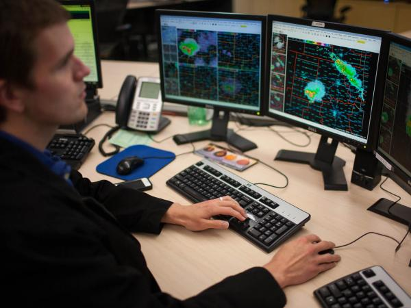 Marc Austin monitors radar and issues warnings at the National Weather Center in Norman, Okla., on Thursday.