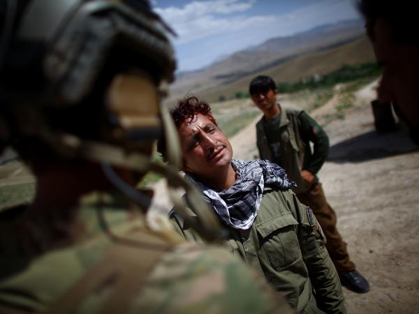 An Afghan police commander, Capt. Daoud, talks with U.S. forces at a checkpoint near Sayed Abad, in Wardak province south of Kabul.