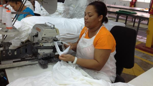 "Aracelis Upia Montero works at the Alta Gracia garment factory in the Dominican Republic. She says she was desperately poor before she began working at the factory, which pays much higher than usual wages. ""I'm now eligible for loans and credits from the bank because I earn a good salary,"" she says."