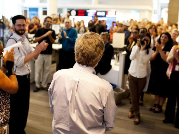 NPR staff members applaud Conan as he leaves the studio.