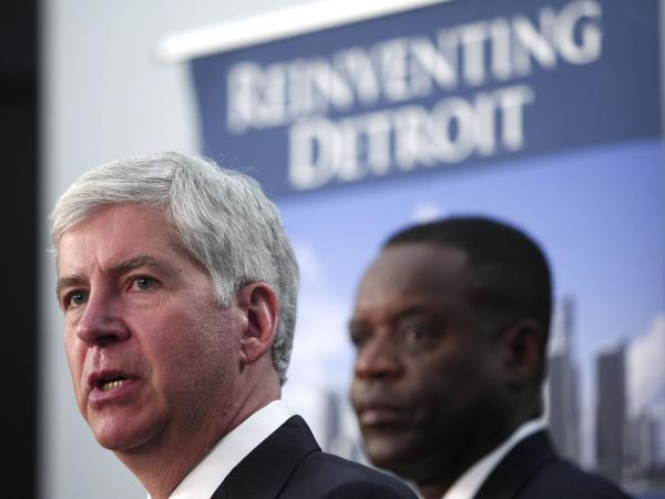 Michigan Gov. Rick Snyder (left) and Detroit's emergency manager Kevyn Orr address Detroit's bankruptcy filing at a news conference on Friday.