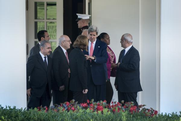 Secretary of State John Kerry leaves the West Wing of the White House with chief negotiators, Israeli Justice Minister Tzipi Livni (back to camera), Palestinian negotiator Saeb Erekat (right) and others, after a meeting with President Obama on Tuesday.