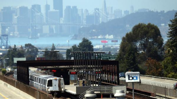 A Bay Area Rapid Transit (BART) train sits in the Rockridge station on Friday in Oakland, Calif. San Francisco Bay Area commuters were bracing for the possibility of a BART strike as a 30-day contract extension was set to expire Sunday at midnight.