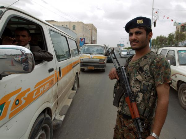 A Yemeni soldier stands guard Tuesday near Sanaa International Airport.