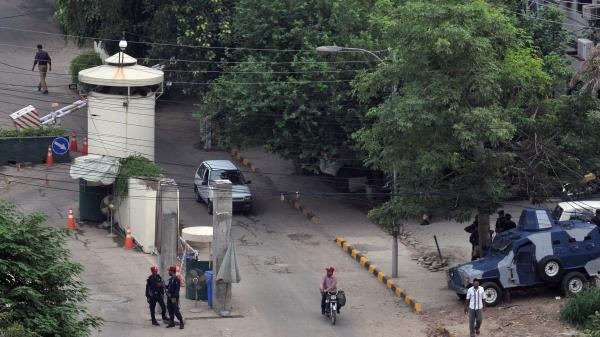 Pakistani security personnel are pictured outside the U.S. Consulate in Lahore on Aug.  5.
