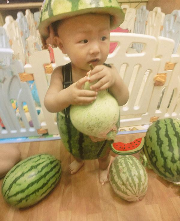 <strong>Mom, I'm not so sure about this: </strong>An example of the photos of babies dressed as watermelons being shared by Chinese Internet users.